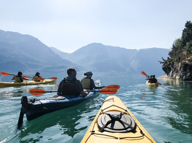 Flash Pack group kayaking the Norweigian Fjords